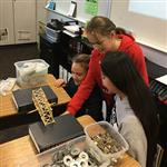 HiCap students engaged in bridge building lesson