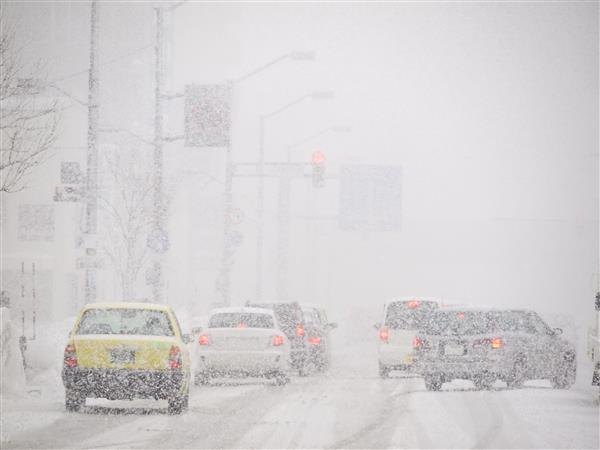 Cars driving on snow-covered roads in the winter