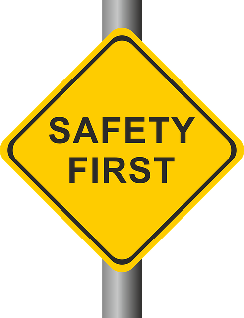yellow road sign reading 'safety first'